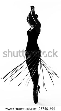 Silhouette fashion slim girl dancing in high heels - stock photo