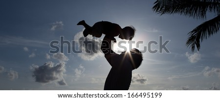 Silhouette Father with Son - stock photo