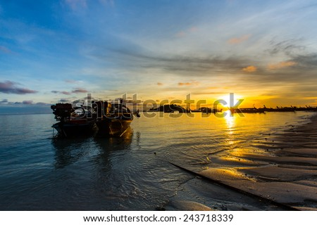 Silhouette fisherman boat with sunrise. - stock photo
