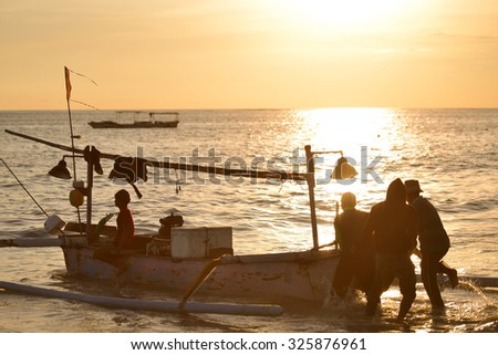 silhouette fisherman goes fishing in the morning - stock photo