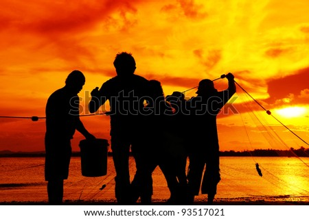 silhouette fisherman working at beach