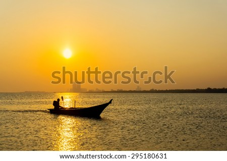 silhouette fishing boat with amazing sunset - stock photo