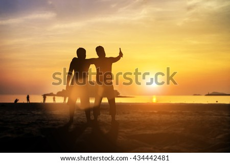 Silhouette friends celebrating a party on the weekend. Dear friend, do not leave each other. Concept friends Party. The coalition parties in the holiday New Year. Day thanks to God. - stock photo