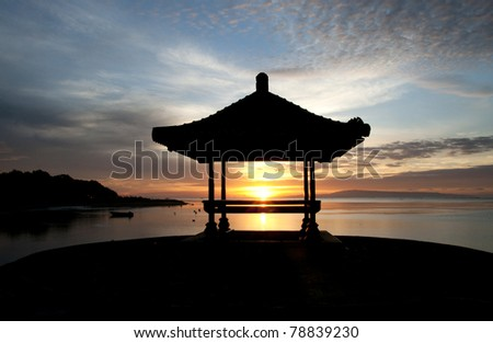 silhouette gazebo and sunrise - stock photo