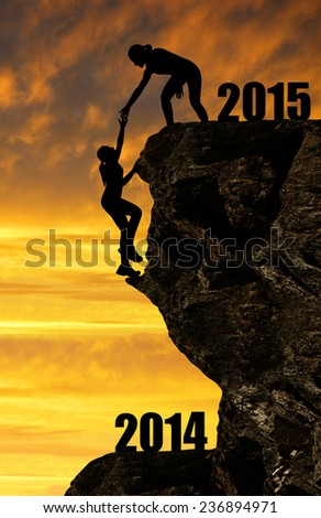 Silhouette girls climbs into the New Year 2015  - stock photo