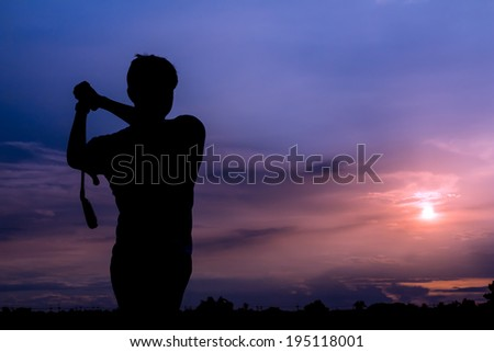 silhouette golfer at beautiful sunset  - stock photo