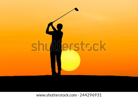 silhouette golfer playing golf on sunrise   - stock photo