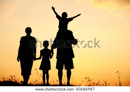 Silhouette, happy children with mother and father, family at sunset, summertime - stock photo