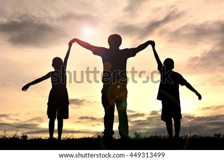 Silhouette happy family open hand at sunset