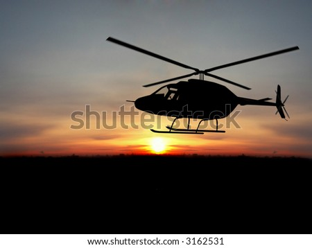 Silhouette  helicopter over orange sunset - stock photo