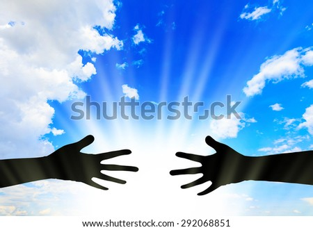 Silhouette helping hands  - stock photo