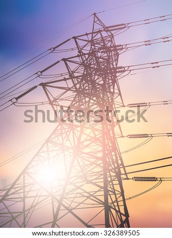 silhouette high voltage post.High-voltage tower over blur sky background.
