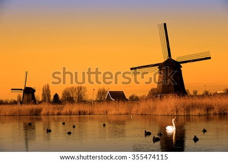 Silhouette Holland old windmill landscape on sunset, Netherlands  - stock photo