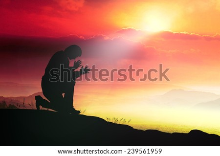 Silhouette human kneeling and praying over over beautiful sunset background. World Mental Health Day, Worship, Forgiveness, Mercy, Humble, Repentance, Reconcile, Adoration, Glorify concept. - stock photo