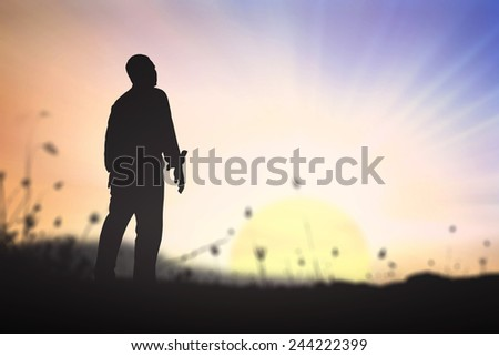 Silhouette human standing over blurred nature background. - stock photo