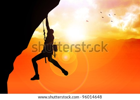 Silhouette illustration of a man figure hanging on the cliff - stock photo