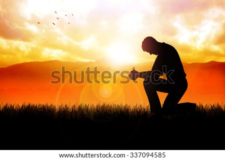 Silhouette illustration of a man praying outside at beautiful landscape - stock photo