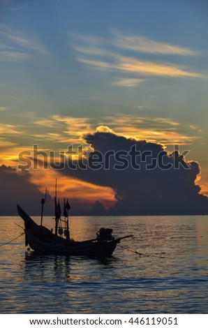 Silhouette image,fisherman's life, Kao Seng Beach sunrise Songkhla Thailand.May 19,2012 - stock photo
