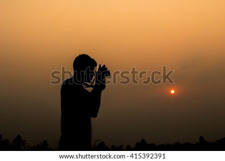 Silhouette image of a man who was photographed - stock photo