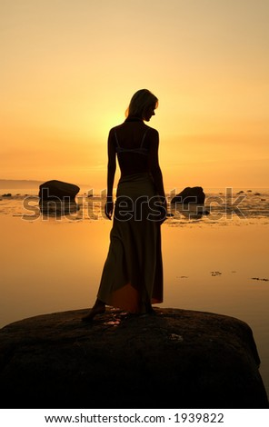 silhouette image of beautiful lady at the seashore - stock photo