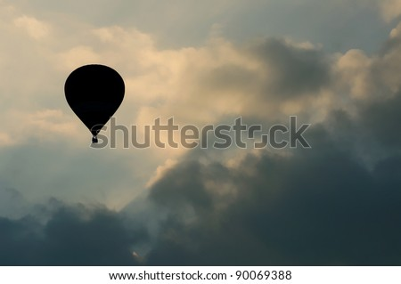 silhouette image of hot air balloon with beautiful blue sky - stock photo