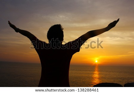Silhouette Image of Man Raising His Hands