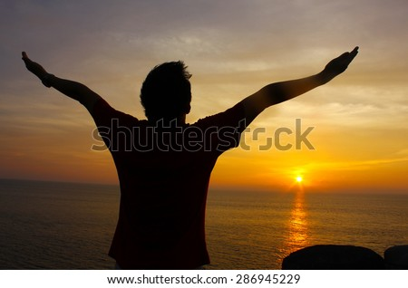 Silhouette Image of Man Raising His Hands - stock photo