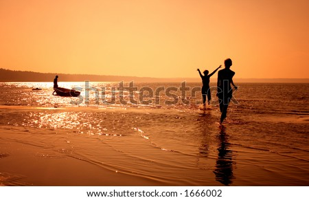 silhouette image of two girls playing on the beach