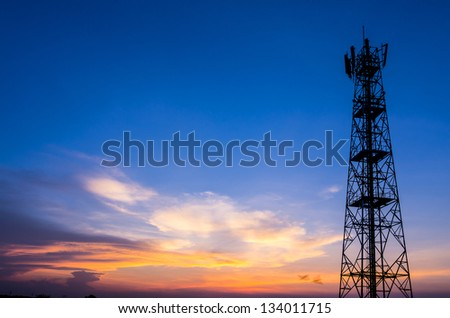 Silhouette in a Antenna transmission. tower at sunset beautiful. - stock photo