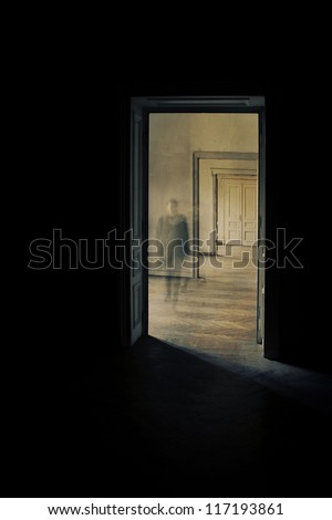 Silhouette in a corridor approaching. Closed door at the end of the hallway.  Linear perspective view through several open doors and empty rooms. - stock photo