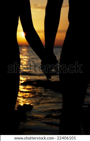 Silhouette in love on sunset