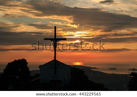 Silhouette Jesus and the cross over sunset