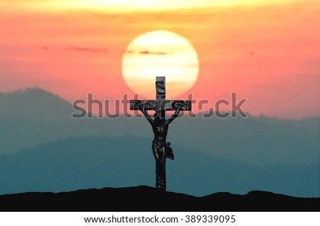 Silhouette Jesus and the cross over sunset on mountain top with copy space (Painting draw water color) - stock photo
