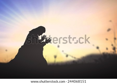 Silhouette Jesus Christ of Nazareth kneeling and praying at garden of gethsemane background. Christmas, Worship, Forgiveness, Mercy, Humble, Repentance, Reconcile, Adoration, Glorify, Peace concept. - stock photo