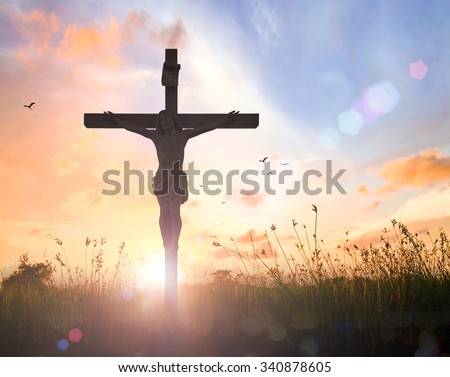 Silhouette Jesus with cross on blurred beautiful autumn sunset with amazing light background. Thanksgiving, Christmas, Worship, Forgiveness, Mercy, Repentance, Adoration, Glorify, Humble, Love concept - stock photo