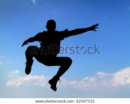 Silhouette jumping man sky background - stock photo