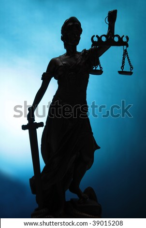 Silhouette Lady of Justice on blue background - stock photo