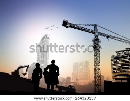 silhouette man engineer looking at blueprints Blurred construction site