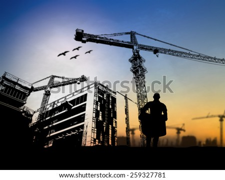 silhouette man engineer looking at blueprints in a building site over Blurred construction