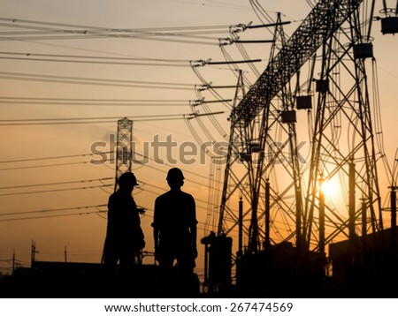 silhouette man engineer looking construction site over Blurred substation