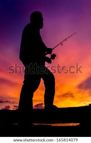 silhouette man fishing  - stock photo