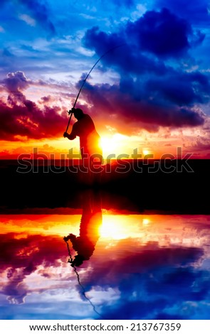 silhouette man fishing