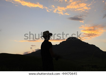 Silhouette man in hat
