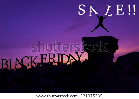 "Silhouette man jumping on stone and holding word ""Sale"" - Black Friday sales concept"