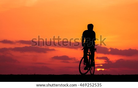 silhouette  man on bicycle.concept of relax.