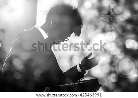 Silhouette man on blurry background,Hope faith concept,Black and white - stock photo
