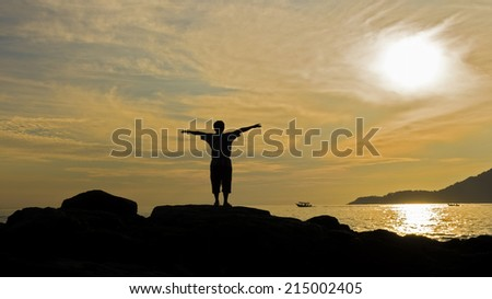 Silhouette man standing at sunset