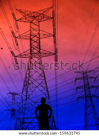 Silhouette man standing in front of electricity pylon background