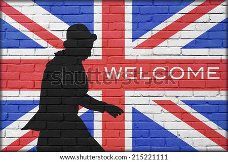 silhouette man with bowler in brick wall background with great britain painted flag and Welcome text