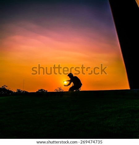 Silhouette man with sunset